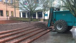 Tractor dumps muck outside Derby Crown Court