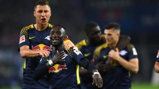"""Leipzig""""s Guinean midfielder Naby Keita and his teammates celebrates after scoring during German first division Bundesliga football match between Hamburger SV and RB Leipzig in Hamburg on September 8, 2017."""