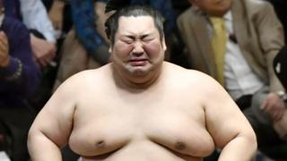 Sumo wrestler Tokushoryu reacts after beating Ozeki Takakeisho at the New Year Grand Sumo Tournament in Tokyo on 26 January 2020, to win his first top-division championship. Kyodo Photo via Credit: Newscom/Alamy Live News