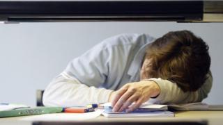 student sleeping on a desk