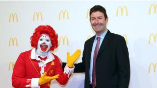 Steve Easterbrook, CEO McDonald, poses with Ronald McDonald during the new McDonald's Flagship Restaurant re-opening at Frankfurt International Airport, Terminal 2, on March 30, 2015 in Frankfurt am Main, Germany. (