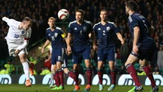 Wayne Rooney scores v Scotland in 2014