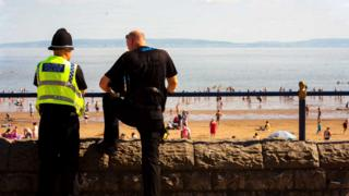 police officers overlooking beach