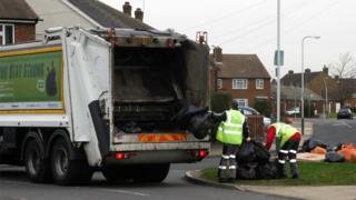 Bin men collecting rubbish in Rainham, Essex, in 2009