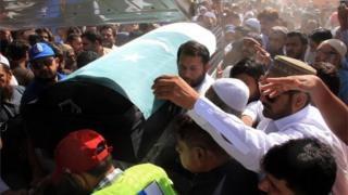 "Relatives and residents carry the coffin of slain Pakistani exchange student Sabika Sheikh, who was killed during a school shooting in Texas, following her body""s arrival from the United States, in Karachi on May 23, 2018."