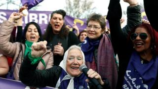 Women attend a demonstration on the occasion of the International Women's Day in Madrid