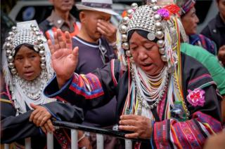 An ethnic Akha shaman perform religious rituals in order to help finding the missing children and their coach at Khun Nam Nang Non Forest Park