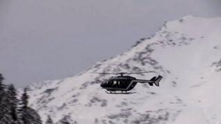 A helicopter flies over the area where an avalanche killed five French Foreign Legionnaires. Photo: 18 January 2016