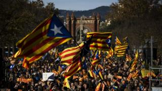 """Pro Independence demonstrators wave """"esteladas"""" or pro independence flags, during a demonstrations to show public support for the Parliament of Catalonia, in Barcelona"""