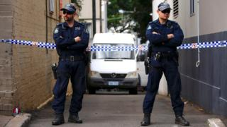 Police cordon off a small alley where officers searched a property after Australian counter-terrorism police arrested four people in raids late on Saturday across several Sydney suburbs, 3 August 2017