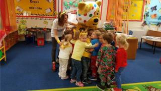 Pudsey the Bear with pupils at Nottage Primary School in Porthcawl