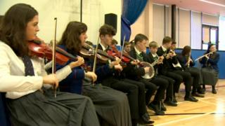 Pupils from Belfast Royal Academy and St Malachy's College share music lessons