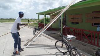 KK Payne helps fix the local bakery on Barbuda