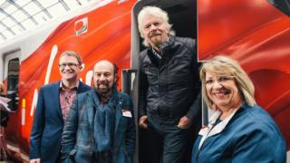 Sir Richard Branson and team on a train