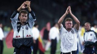 A tearful Paul Gascoigne applauds the England fans alongside Terry Butcher after England were defeated by West Germany in a penalty shoot out.