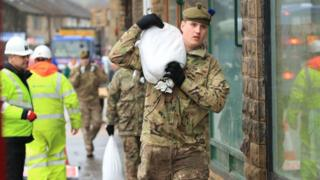 Soldiers assist with flood defences in the Upper Calder Valley in West Yorkshire