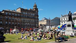 Lots of Glaswegians sunning themselves in George Square this afternoon