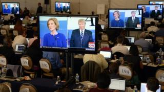 Media watch an exchange between US Republican presidential candidates Donald Trump and Carly Fiorina during the second US Republican Presidential candidates debate at the Ronald Reagan Presidential Library in Simi Valley, California, USA, 16 September 2015.