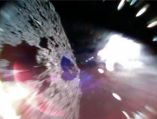 A picture of the asteroid taken by a robot rover and tweeted by a JAXA account.