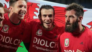 Gareth Bale (centre) with Wayne Hennessey and Joe Ledley