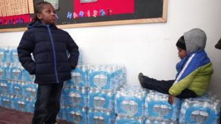 Children waiting for water
