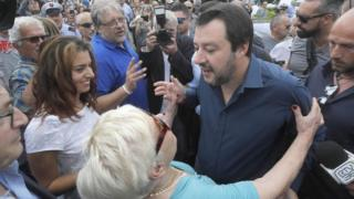 The leader of Italy's right-wing League - Matteo Salvini - meets a supporter