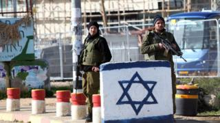 Israeli soldiers guard the Gush Etzion junction in West Bank. 5 Jan 2016