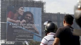 "Motorists ride past a billboard displaying Facebook""s Free Basics initiative in Mumbai, India, December 30, 2015"