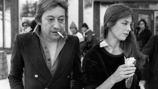 French music great Serge Gainsbourg pictured smoking with his wife Jane Birkin