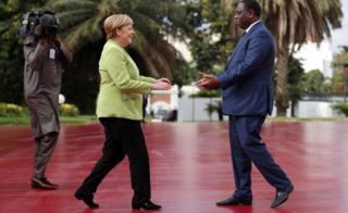 Senegal President Macky Sall greets German leader Angela Merkel in Dakar, Senegal - Wednesday 29 August 2018