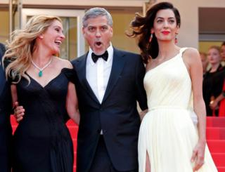 Cast members Julia Roberts, George Clooney and his wife Amal Clooney pose on the red carpet