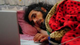 Jihad Diyab lies in a mattress on the floor of his house as he holds a hunger strike in Montevideo (09 September 2016)