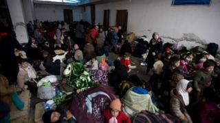 Syrians rest in a camp built by IHH Humanitarian Relief Foundation near Bab al-Salam border gate on Turkey's border in Azez district of Aleppo as they flee to Turkey to escape heavy Syrian regime and Russian airstrikes