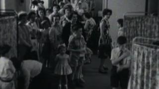 Children queuing for a police vaccination