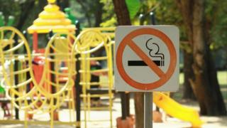 A playground with a no smoking sign