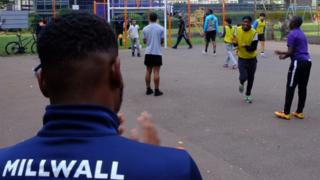 Youngsters play football on the Avondale Square Estate