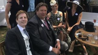 Johnno Spence, centre, wearing the suit destined for Thomas Markle