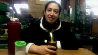 Natalia Sosa drinks mate tea in the factory in which she works