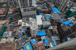 A aerial view showing rescuers at the site of collapsed building in Dongri area of Mumbai, India, 17 July 2019