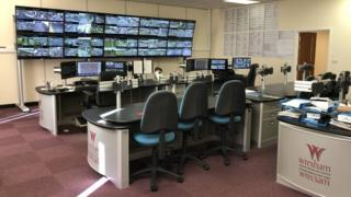 Wrexham CCTV control room with multiple screens