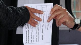 Ballot paper changing hands