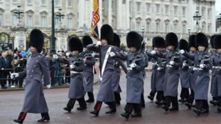Soldiers from the Coldstream Guards during the Changing of the Guard at Buckingham Palace in London,