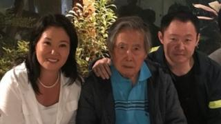 Former Peruvian President Alberto Fujimori poses for a photo with daughter Keiko and son Kenji in Lima, Peru, in this photo obtained from social media, January 4, 2018.