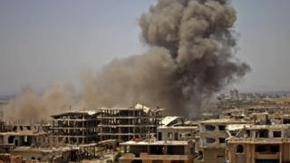 Smoke rises above a rebel-held area of Deraa after an air strike by Syrian government forces (28 June 2018)