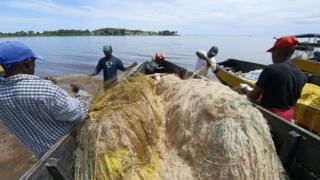 Unloading boats at Nakatiba landing site