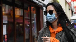 "A woman wears a face mask in Chinatown in London, Britain, 04 February 2020. London""s Chinatown is feeling the impact of the Coronavirus as restaurants are seeing a down in customers following the confirmation of new coronavirus cases in the UK."