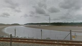 Pylon on the Dwyryd estuary with the rail line in the foreground