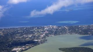 An aerial view of the Tongan capital Nuku'alofa and the sea
