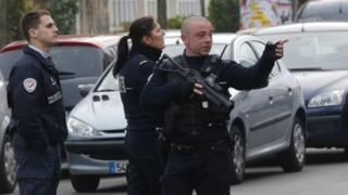 Police officers patrol near the school in Aubervilliers