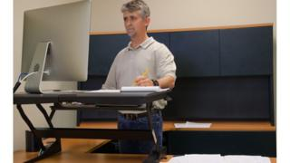 Man using stand-up desk